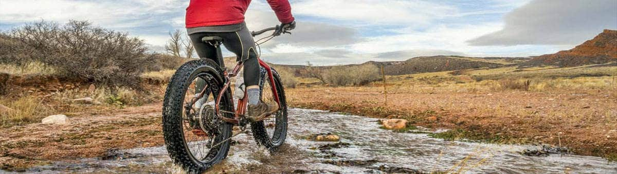 Riding fat tire bike in the shallow river
